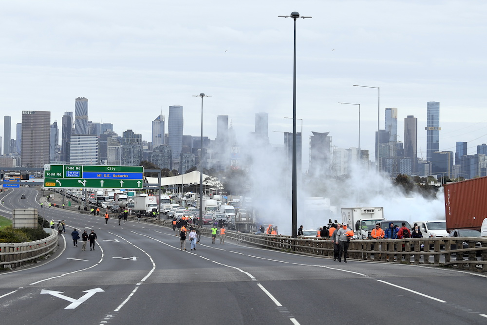 Construction workers and far right activists protest against coronavirus disease (Covid-19) restrictions on the West Gate Freeway in Melbourne, Australia, September 21, 2021. — Reuters pic