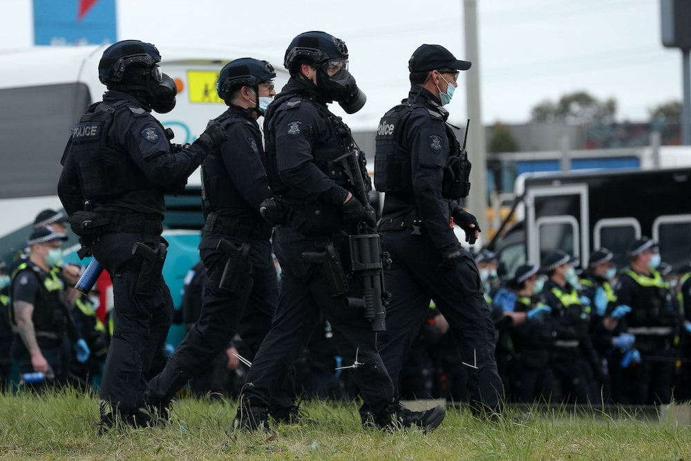 Police officers patrol during a protest against Covid-19 regulations in Melbourne September 21, 2021. — AFP pic