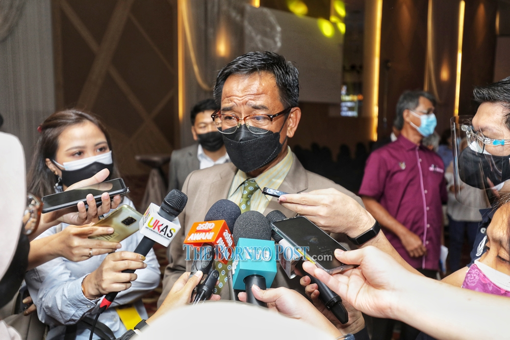 Tourism, Arts and Culture Minister Datuk Abdul Karim Rahman Hamzah speaking to reporters after officiating a 'Seni Perdana' dialogue at a local hotel in Kuching, September 22, 2021. — Borneo Post Online pic