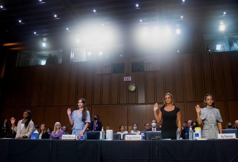 US Olympic gymnasts Simone Biles, McKayla Maroney, Maggie Nichols, and Aly Raisman are sworn in to testify during a Senate Judiciary hearing about the Inspector General's report on the FBI handling of the Larry Nassar investigation of sexual abuse of Olympic gymnasts, on Capitol Hill, in Washington, DC, September 15, 2021. — Reuters pic