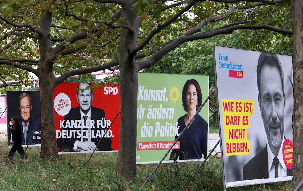 File photo of election posters of Germany's top candidates for chancellor, Armin Laschet, Olaf Scholz, Annalena Baerbock, and Christian Lindnerare pictured in Berlin, Germany, September 16, 2021. — Reuters pic