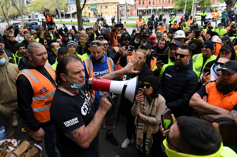 A unionist addresses construction workers protesting work-related Covid-19 restrictions at the Construction, Forestry, Maritime, Mining and Energy Union (CFMEU) headquarters in Melbourne, Australia, September 20, 2021. ― AAP Image/James Ross via Reuters