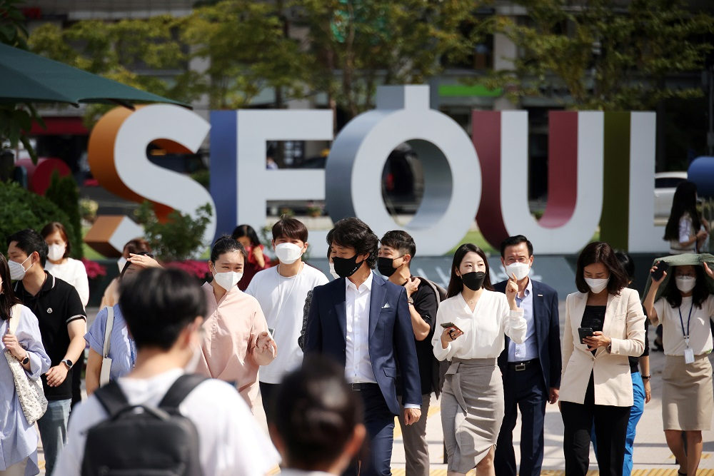 Commuters wear masks to avoid contracting the coronavirus disease, walk on a zebra crossing in Seoul, South Korea September 24, 2021. ― Reuters pic