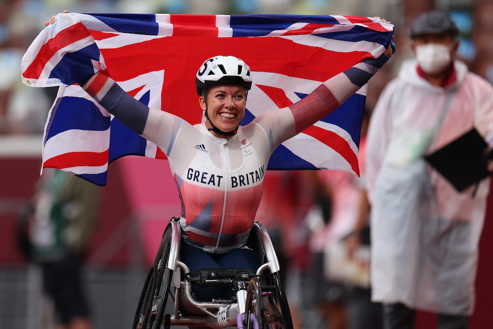 Hannah Cockroft of Britain celebrates after winning gold and setting a Paralympic Record at the Tokyo 2020 Paralympic Games at the Olympic Stadium in Tokyo, September 4, 2021. — Reuters pic