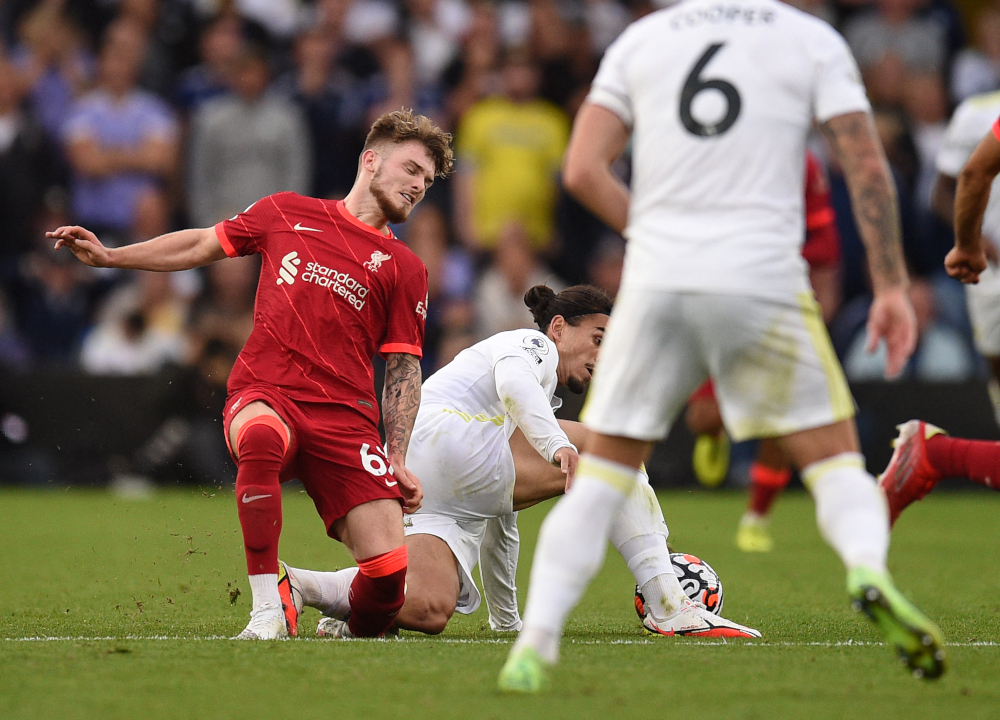 Liverpool striker Harvey Elliott suffers a serious leg injury following a tackle by Leeds United defender Pascal Struijk during the English Premier League football match at Elland Road in Leeds, northern England, September 12, 2021. — AFP pic