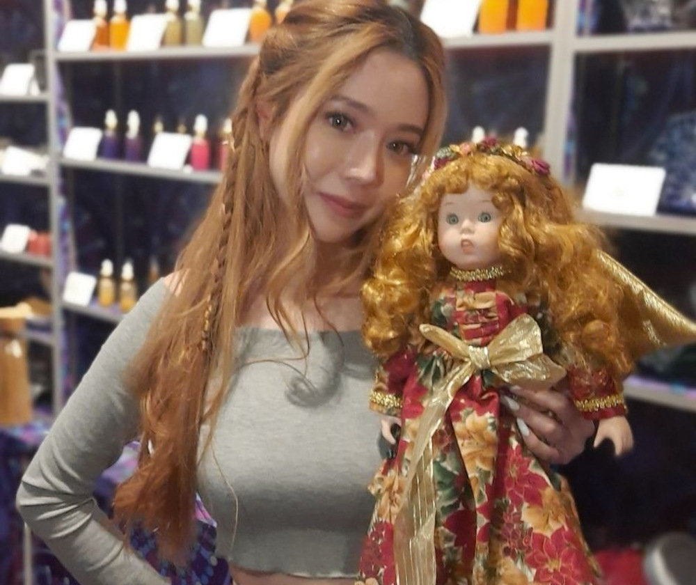 Bambi Leong, a self-proclaimed clairvoyant, has a collection of books of spells and dolls in her shop in Sim Lim Square electronics mall. — Picture via Facebook/BambiNe