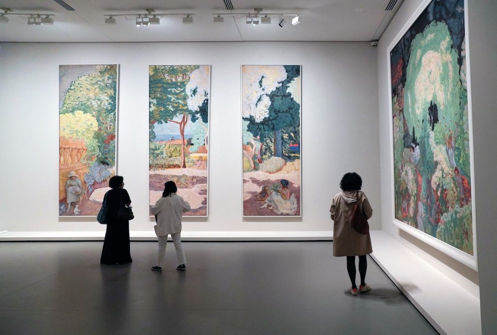 Visitors look at paintings by French painter Pierre Bonnard during a press visit of the exhibition 'The Morozov Collection — Modern art icons at the Fondation Louis Vuitton in Paris on September 15, 2021. — AFP pic