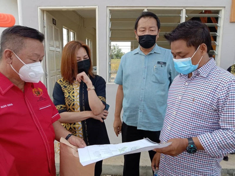Datuk Masiung Banah (right) being briefed about the project during his visit, September 17, 2021. — Borneo Post Online pic