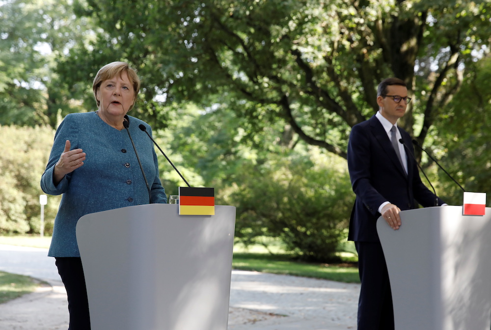 German Chancellor Angela Merkel and Polish Prime Minister Mateusz Morawiecki attend a news conference after meeting in Royal Lazienki Park in Warsaw, Poland, September 11, 2021. — Reuters pic