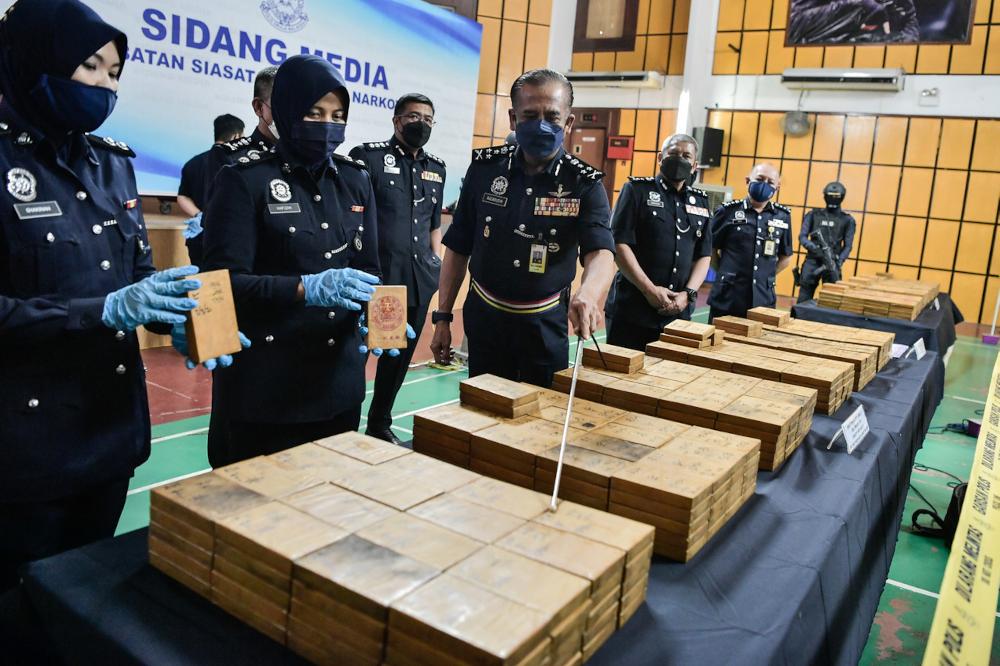Bukit Aman Narcotics Criminal Investigation Department (JSJN) director Datuk Razarudin Husain with the seized drugs worth RM34.1 million during a press conference at Seberang Perai Tengah district police headquarters, September 9, 2021. — Bernama pic