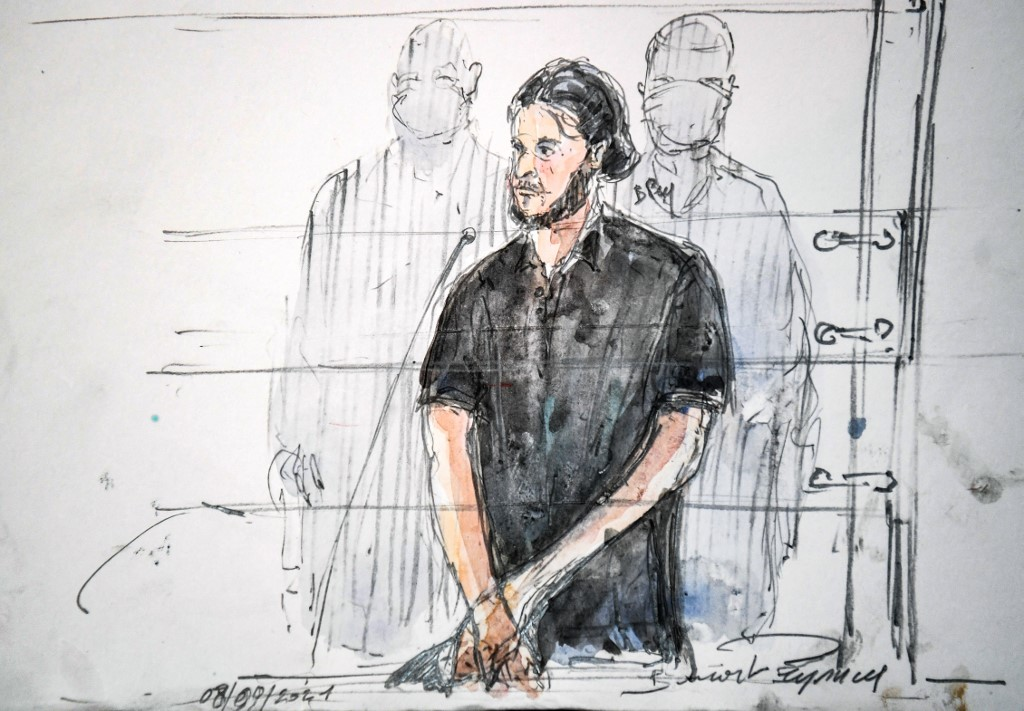 This court-sketch shows Salah Abdeslam, standing on the first day of the trial of the November 2015 Paris attacks' taking place in a temporary courtroom set up for the proceedings at the Palais de Justice of Paris, on September 8, 2021. — AFP pic
