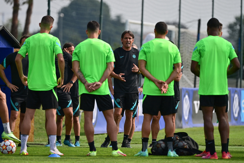 Inter Milan's Italian coach Simone Inzaghi speaks with his players during a training session in Appiano Gentile, on the eve of the Uefa Champions League Group D football match between Inter Milan and Real Madrid in Milan, September 14, 2021. — AFP pic