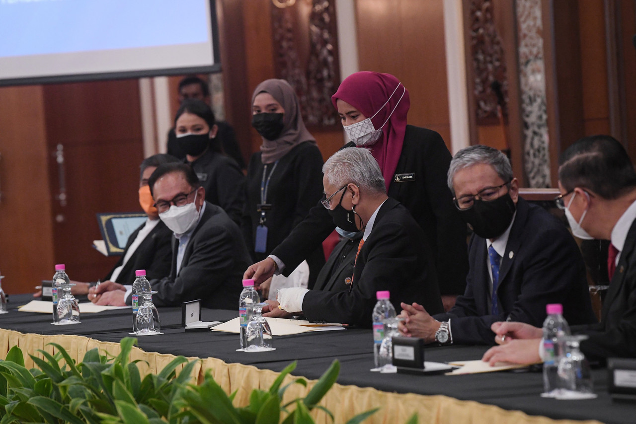 Prime Minister Datuk Seri Ismail Sabri Yaakob (centre) attending the signing ceremony of the Memorandum of Understanding on Transformation and Political Stability Between the Federal Government and Pakatan Harapan at Parliament House, September 13, 2021.