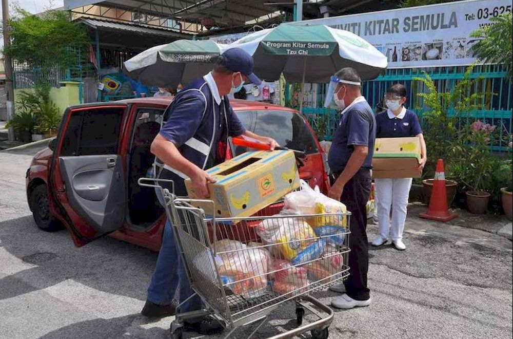 Tzu Chi Kuala Lumpur and Selangor's volunteers at the Jinjang Recycling Centre in Kepong. — Picture courtesy of Tzu Chi KL and Selangor