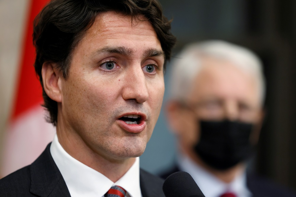 Canada's Prime Minister Justin Trudeau tells reporters that the two Canadian citizens who were detained by Beijing have left Chinese airspace and will arrive back in Canada early today, in Ottawa, Ontario, Canada September 24, 2021. ― Reuters pic