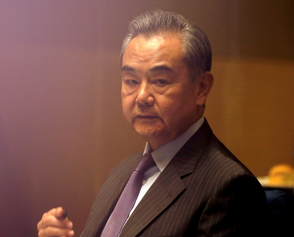 File photo of China's Foreign Minister Wang Yi listening during a meeting in Manila, Philippines January 16, 2021. — Reuters pic