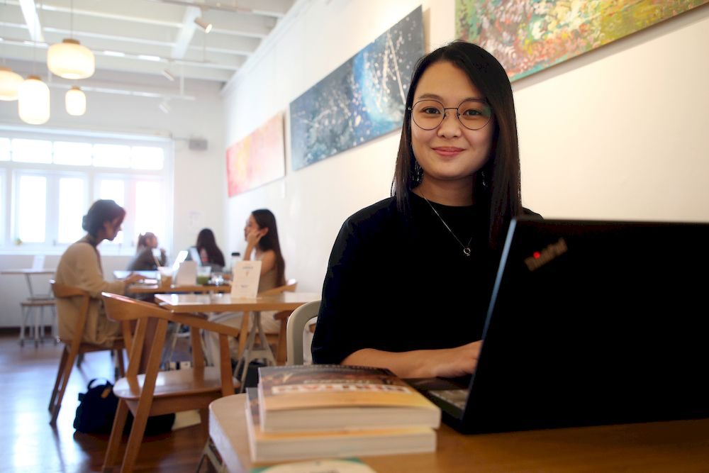 Ms Ashley Chen, who does marketing for a travel agency, works mostly at a cafe in Chinatown, which is run by her employer, but she has the flexibility to be constantly on the move. — TODAY pic
