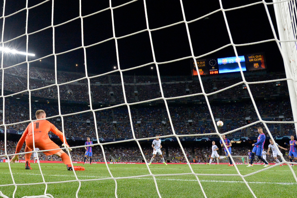 Bayern Munich forward Thomas Mueller scores a goal despite Barcelona's goalkeeper Marc-Andre ter Stegen during the Uefa Champions League first round group E football match between Barcelona and Bayern Munich at the Camp Nou stadium in Barcelona, September 14, 2021. — Reuters pic