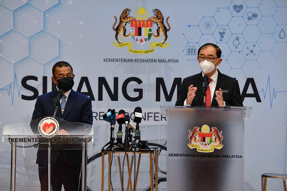 Deputy Education Minister Datuk Dr Mah Hang Soon (right) speaks during a joint press conference with Deputy Health Minister Datuk Dr Noor Azmi Ghazali (left) in Putrajaya September 22, 2021. — Bernama pic