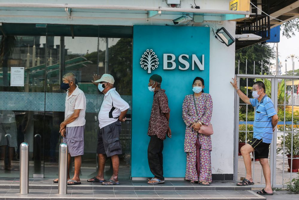 People queue in front of a Bank Simpanan Nasional branch in Klang September 6, 2021. — Picture by Yusof Mat Isa