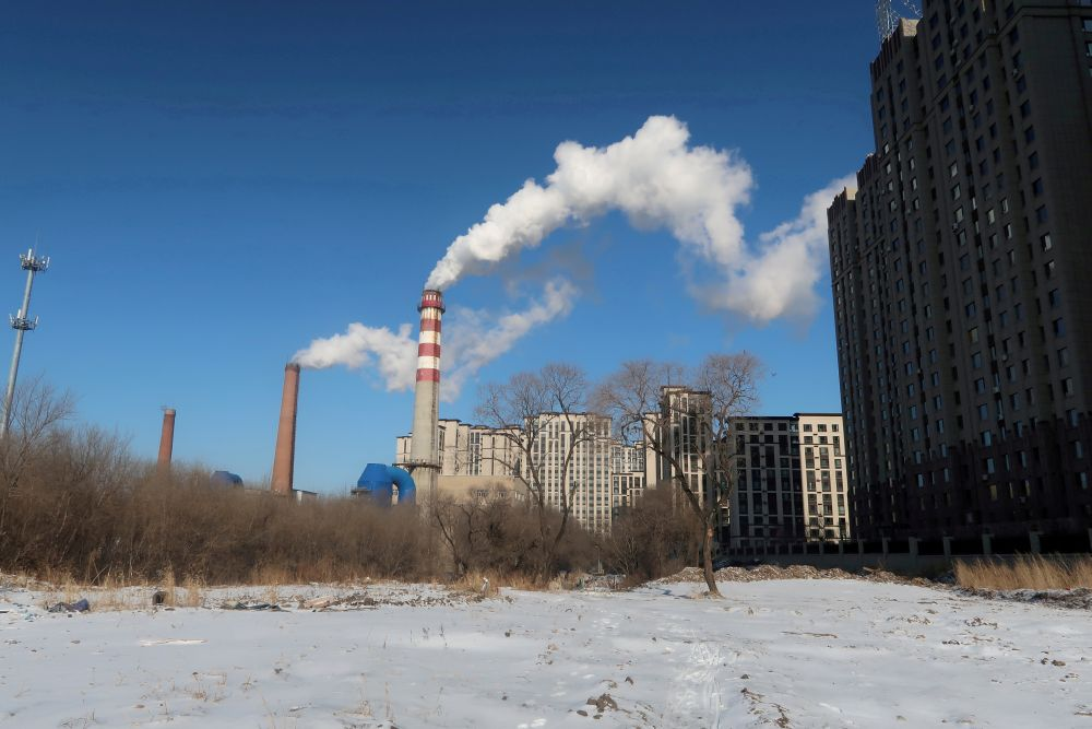 A coal-fired heating complex is seen behind snow-covered ground in Harbin November 15, 2019. — Reuters pic