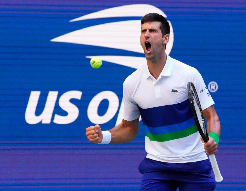 Novak Djokovic of Serbia reacts after a third set winner against Kei Nishikori of Japan at the USTA Billie Jean King National Tennis Centre September 4, 2021. — Reuters pic