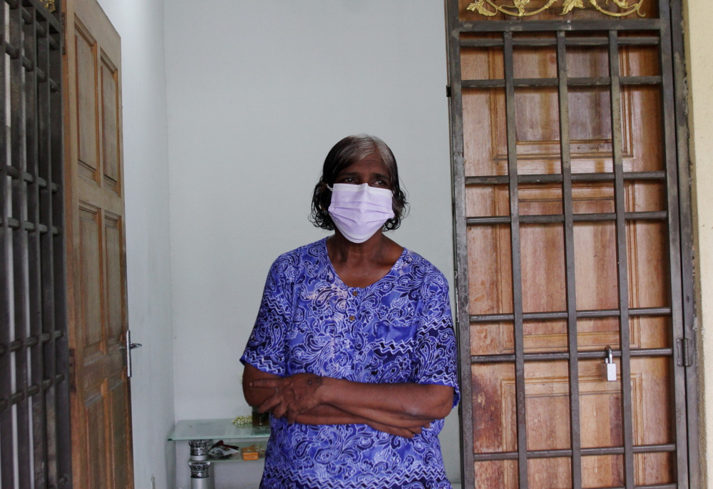 S. Thava Sagayam's widow E. Philomena, after receiving a total of RM14,737 and a lifelong pension from the Social Security Organisation (Socso) September 3, 2021, for his death from head injuries suffered during an assault while on duty as a security guard in December. — Bernama pic
