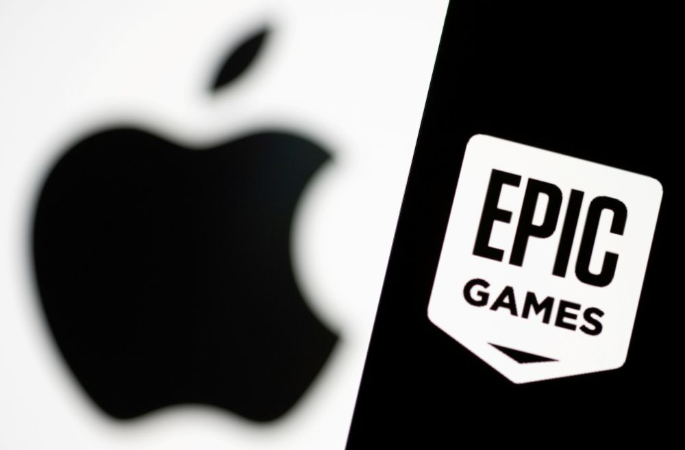 Smartphone with Epic Games logo is seen in front of Apple logo in this illustration taken, May 2, 2021. — Reuters pic