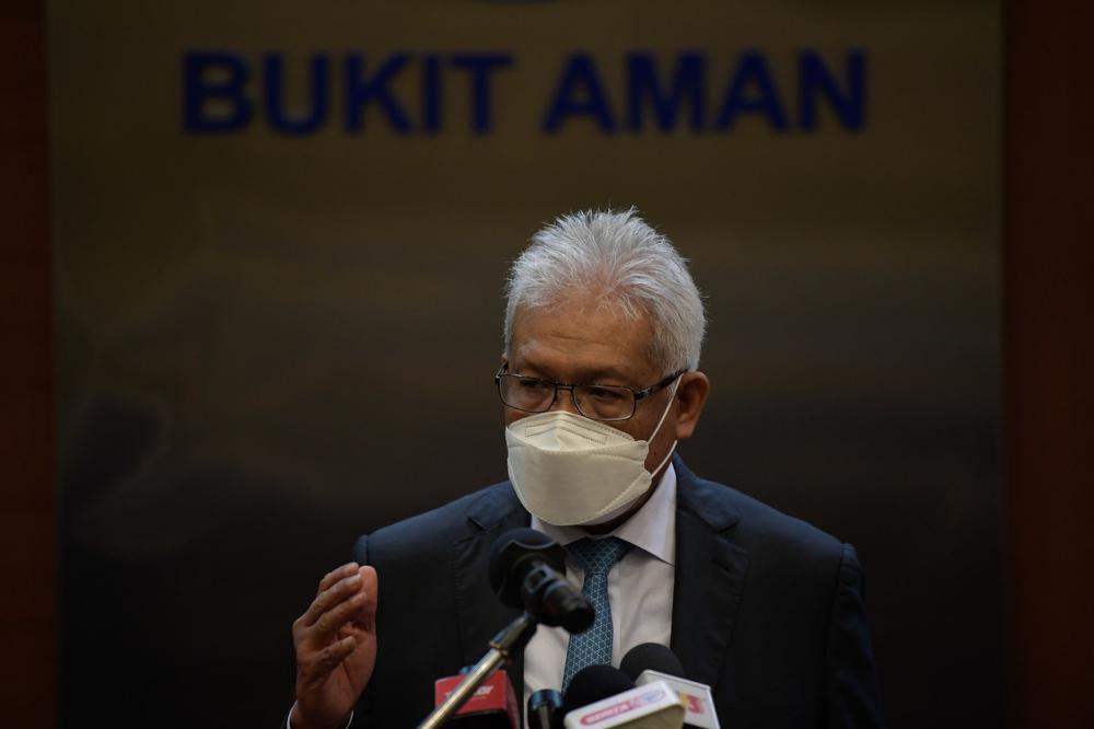 Home Minister Datuk Seri Hamzah Zainudin speaks at a press conference at Bukit Aman, September 29, 2021. — Bernama pic