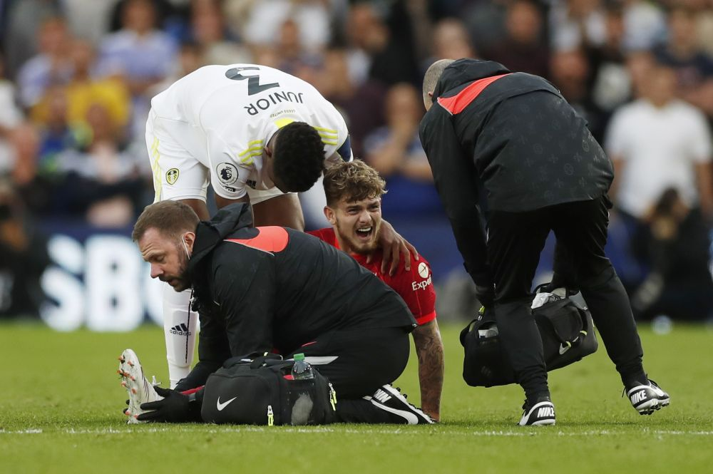 Liverpool's Harvey Elliott reacts as he receives medical attention after sustaining an injury against Leeds United at Elland Road, Leeds  September 12, 2021. — Reuters pic