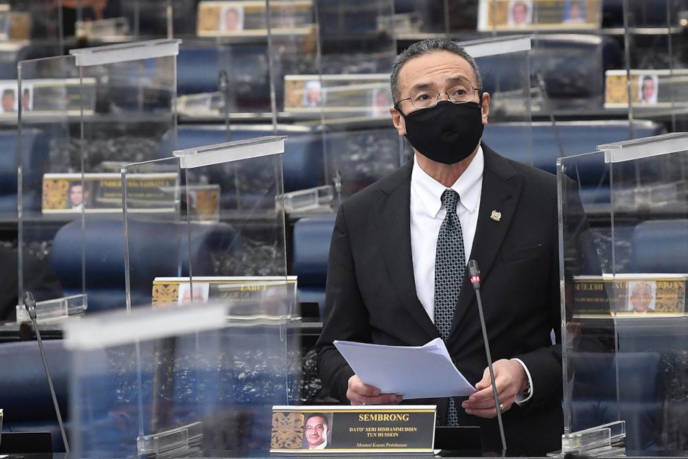 Senior Defence Minister Datuk Seri Hishammuddin Hussein during a winding-up debate on the motion of thanks for the royal address in the Dewan Rakyat, September 22, 2021. — Bernama pic