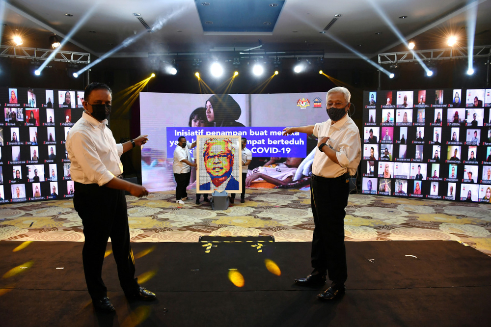 Prime Minister Datuk Seri Ismail Sabri Yaakob attends the Malaysian Family Ikram House Launching Ceremony at the Ministry of Housing and Local Government (KPKT) in Putrajaya, September 24, 2021. With him is Housing and Local Government Minister Datuk Seri Reezal Merican Naina Merican. — Bernama pic