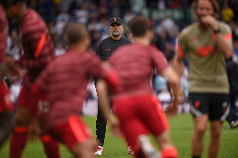 Liverpool manager Jurgen Klopp watches his players warm up during the English Premier League football match between Leeds United and Liverpool at Elland Road in Leeds, northern England, September 12, 2021. — AFP pic