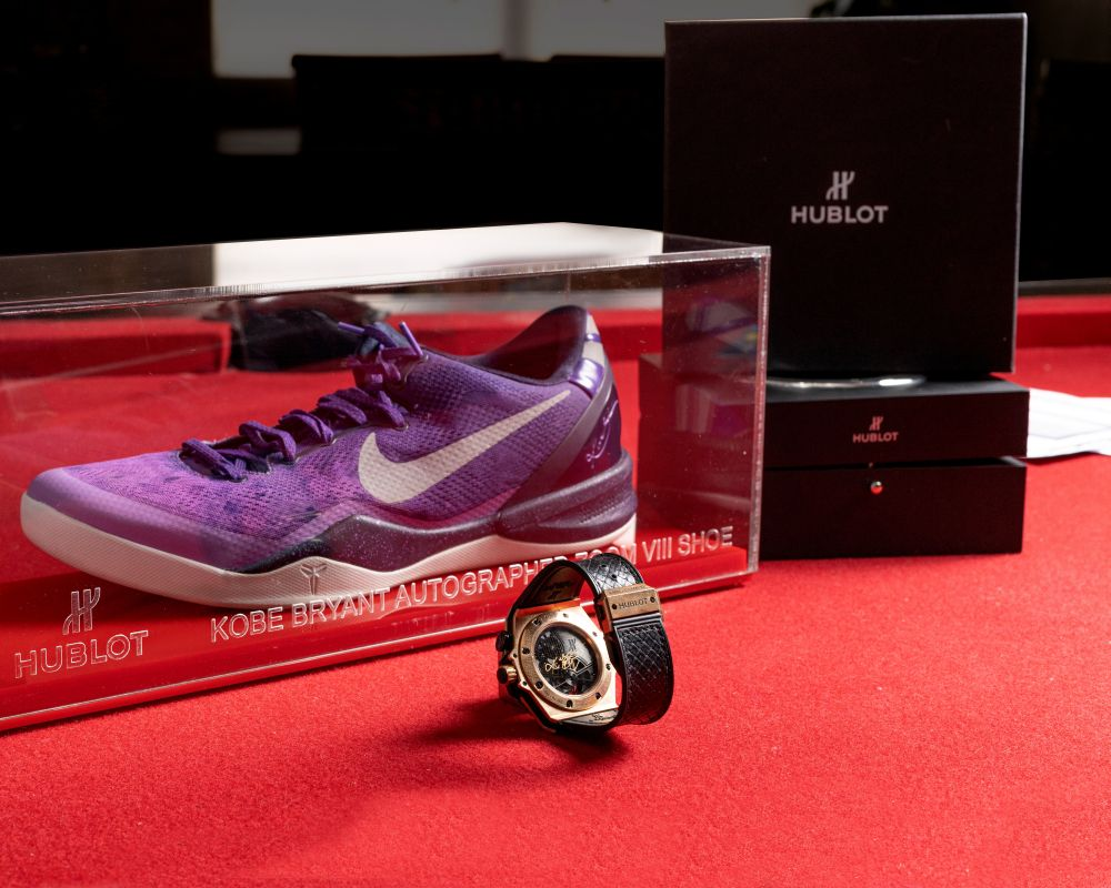 The autographed Kobe Bryant's Hublot King Power 'Black Mamba' Chrono Tourbillon watch and Nike Zoom VIII sneaker are pictured in this undated handout photo. — Reuters pic
