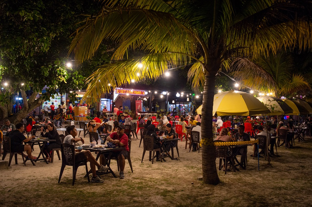 Patrons are seen here having their meals at a restaurant in Pantai Cenang September 16, 2021.