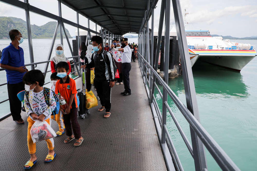 Tourists arrive at the jetty, as Langkawi reopens to domestic tourists, amid the coronavirus disease (Covid-19) pandemic, in Malaysia September 16, 2021. — Reuters pic