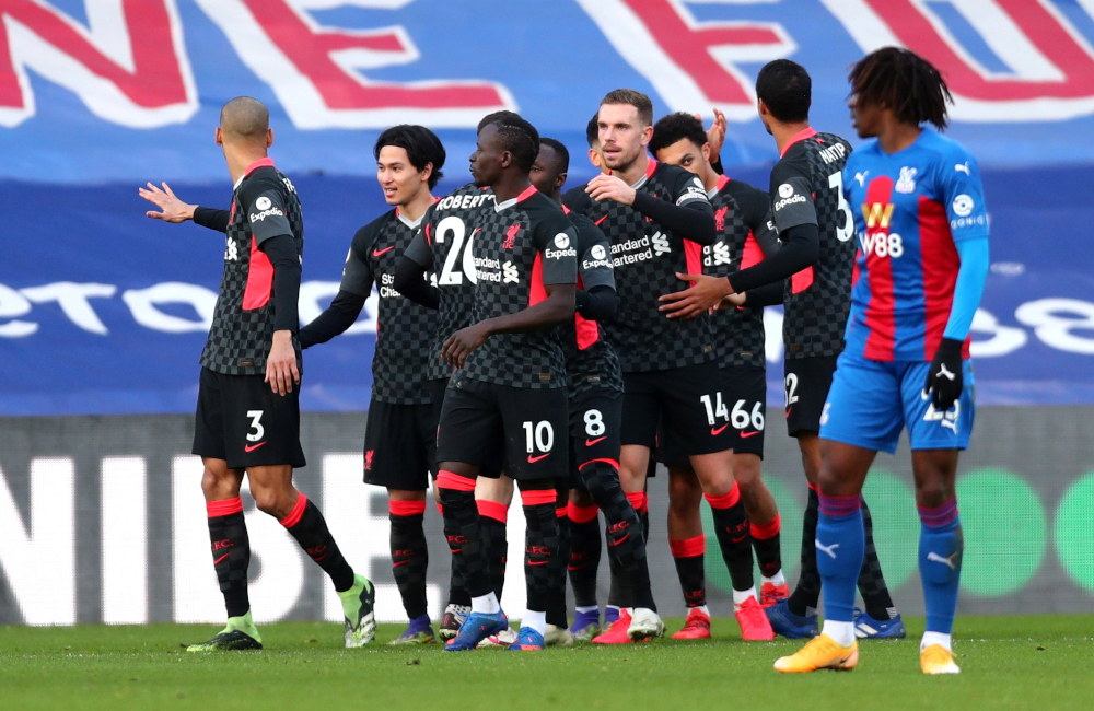 Liverpool's Jordan Henderson celebrates scoring their fourth goal with teammates during a match against Crystal Palace at Selhurst Park, London, December 19, 2020. — Reuters pic