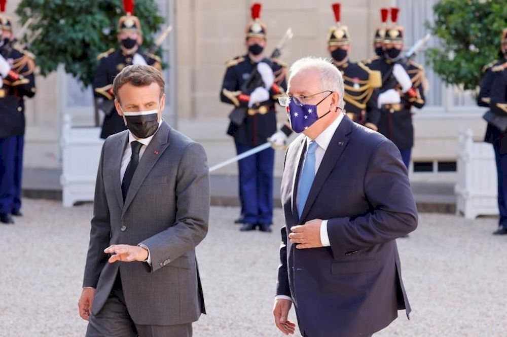 File photo of French President Emmanuel Macron and Australian Prime Minister Scott Morrison walking in front of the Elysee Palace in Paris, France, June 15, 2021. — Reuters pic