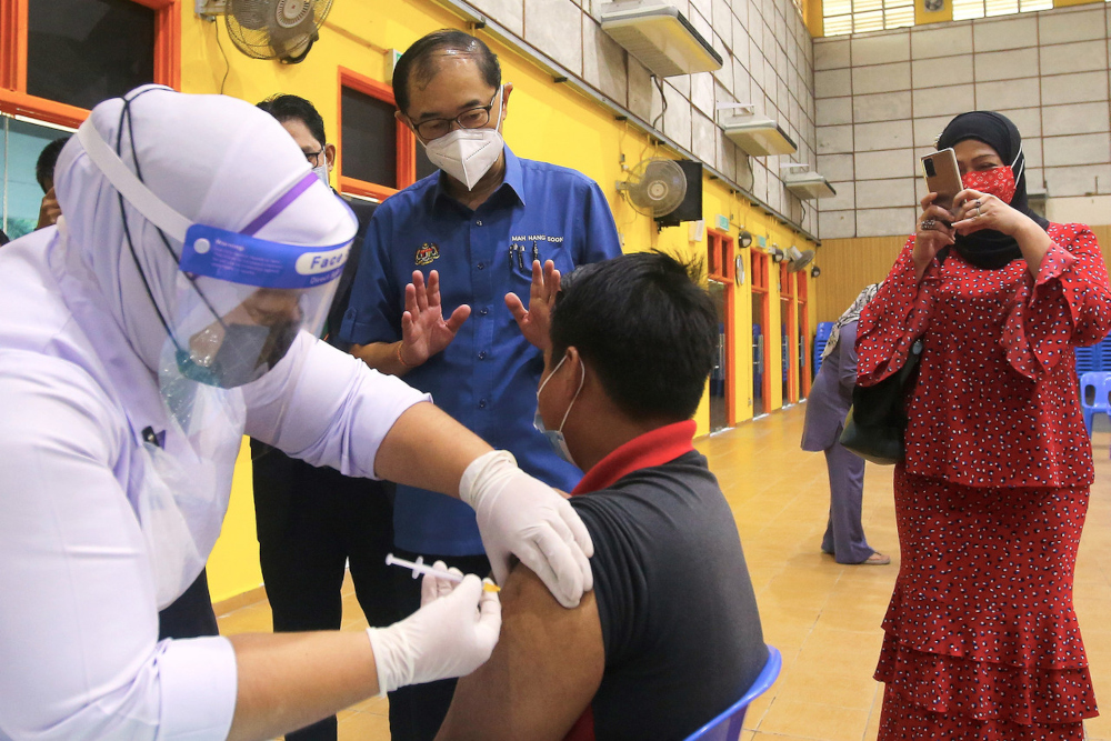 Deputy Education Minister I Datuk Dr Mah Hang Soon speaks to a student during a visit to a PICK for Adolescent programme in Seremban, September 27, 2021. — Bernama pic