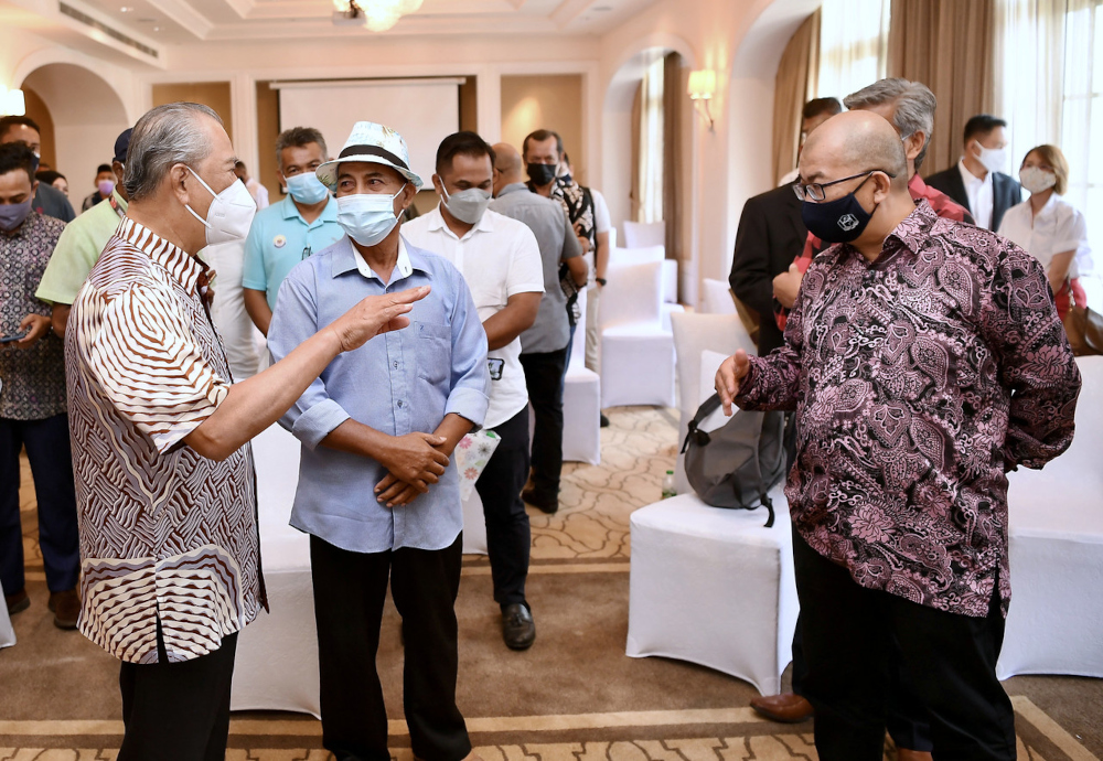 National Recovery Council chairman Tan Sri Muhyiddin Yassin speaks to Langkawi hotel, homestay and rental car operators as well as taxi drivers in Langkawi, September 16, 2021. — Bernama pic