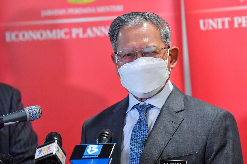 Datuk Seri Mustapa Mohamed addresses a media conference at the Setia Perdana Complex in Putrajaya September 1, 2021. — Bernama pic