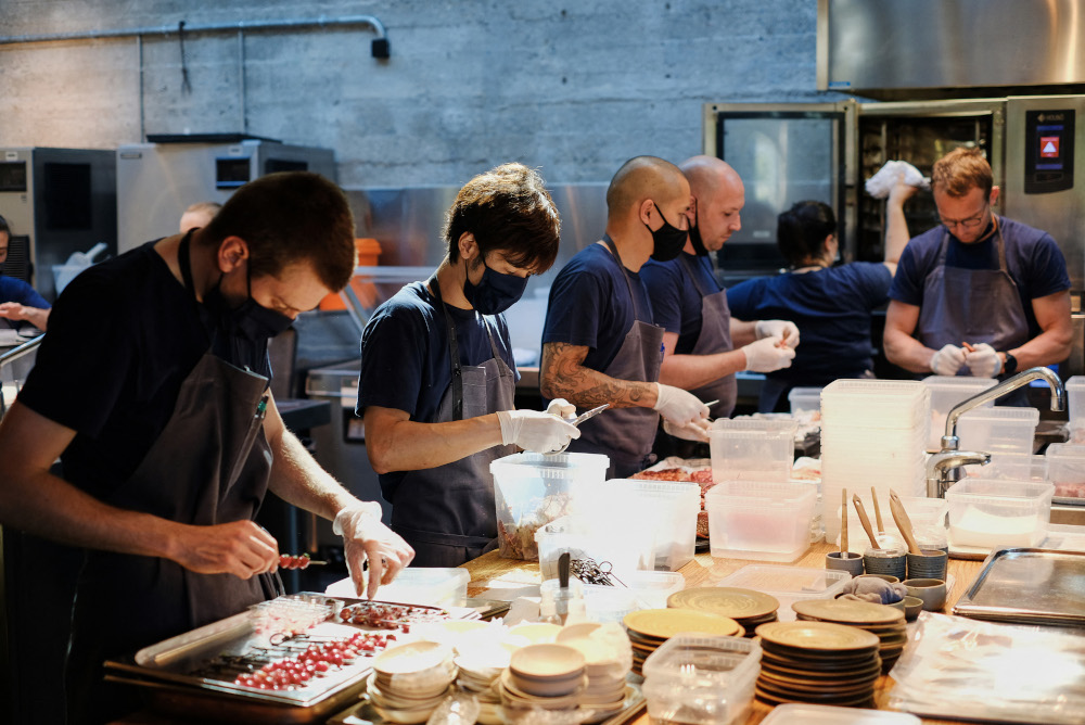 Staff at Danish restaurant Noma work in the kitchen, May 31, 2021 in Copenhagen. — AFP pic