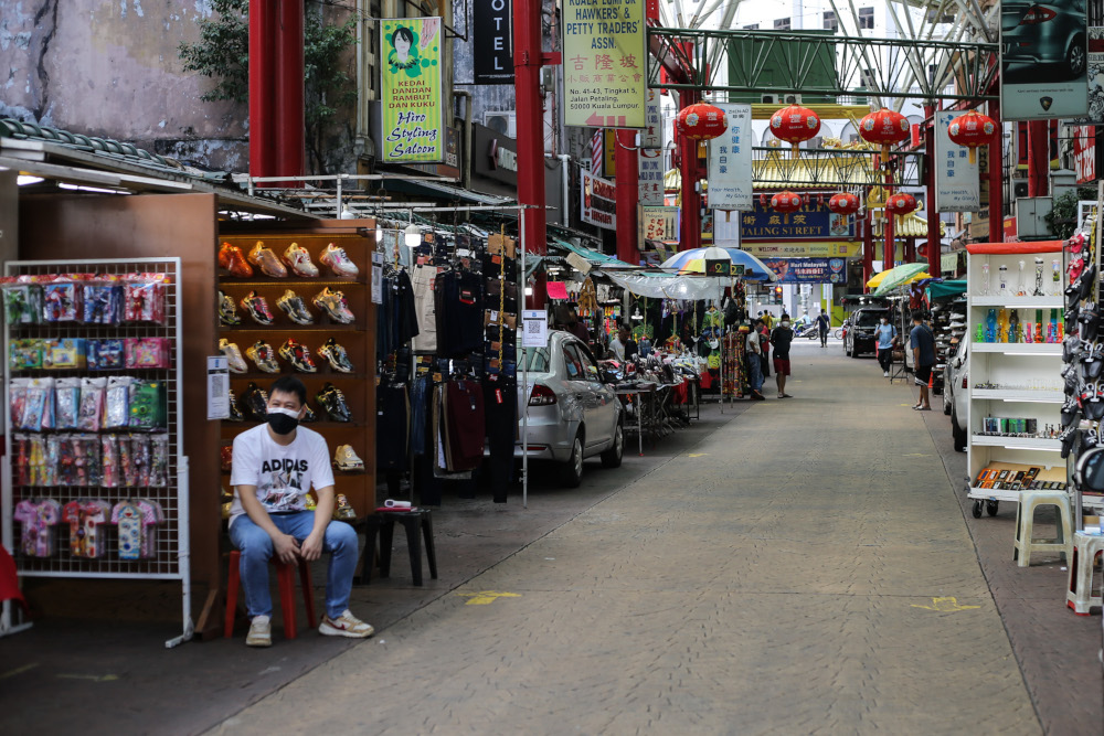 Traders in Petaling Street open for business despite a lack of customers amid the Covid-19 pandemic September 20, 2021. — Picture by Ahmad Zamzahuri
