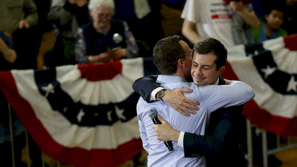 Pete Buttigieg hugs his husband, Chasten, in February 2020 during the Democratic presidential primaries. — Getty Images North America/AFP pic