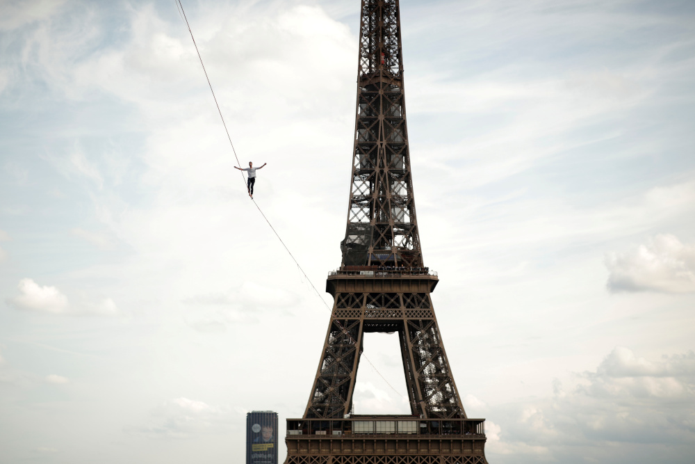 French acrobat Nathan Paulin walks on a slackline between the Eiffel Tower and the Theatre National de Chaillot as part of events around France for National Heritage Day in Paris September 18, 2021. — Reuters pic