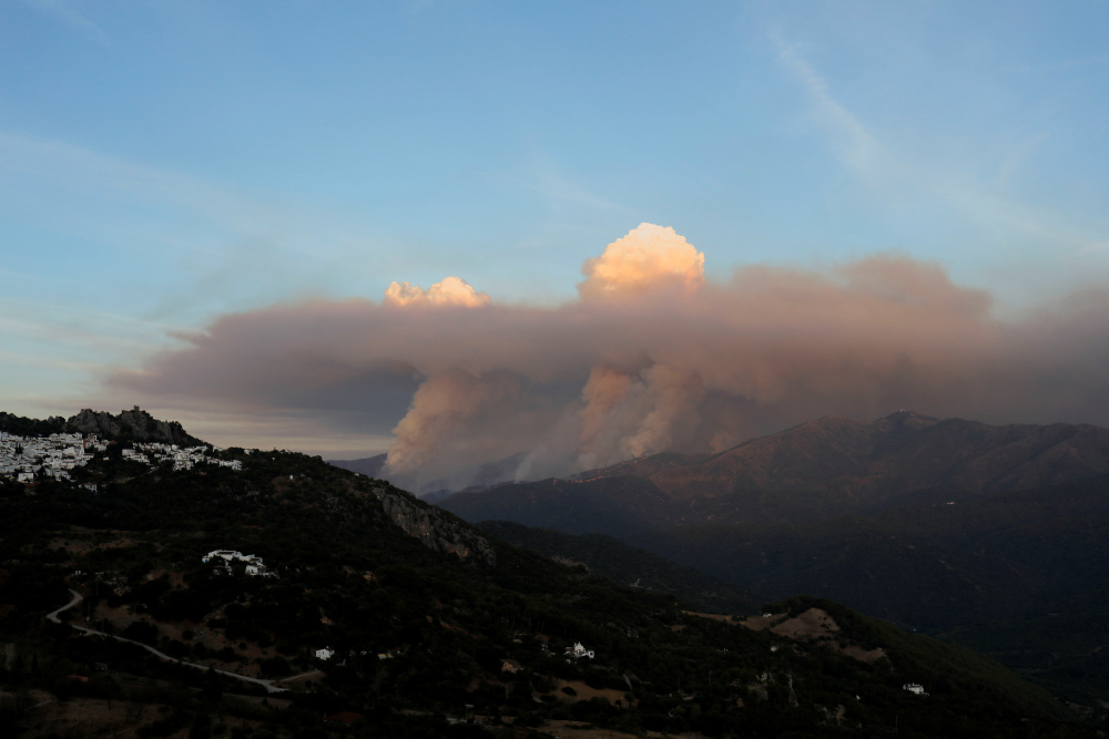 View of clouds of smoke named 'pyrocumulus', according to the Andalusian Fire Prevention and Extinction Plan (Infoca), from a wildfire on Sierra Bermeja mountain, as seen from Gaucin, Spain, September 10, 2021. — Reuters pic