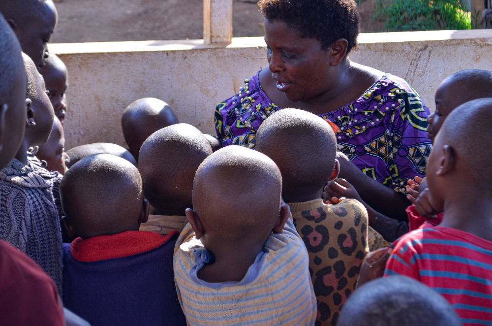 Orphanage director Dorcas Mbambu distributes candy to Ebola orphans at the House of Compassion for Children in Need in Butembo, Democratic Republic of Congo, August 26, 2021. — Djiress Baloki/Thomson Reuters Foundation pic