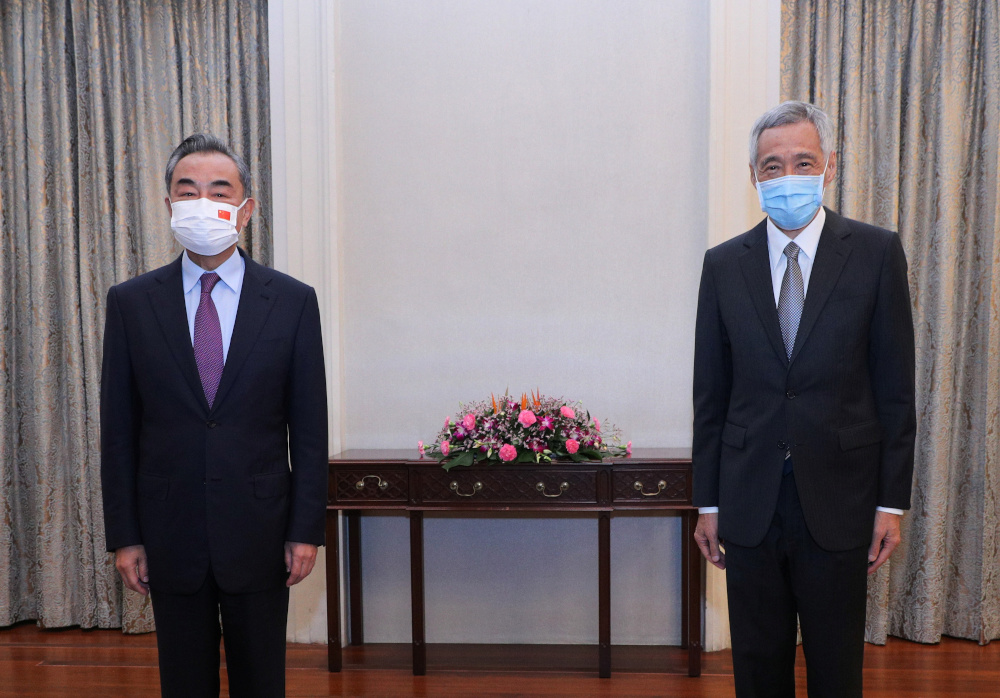 China's Foreign Minister Wang Yi meets with Singapore's Prime Minister Lee Hsien Loong at The Istana in Singapore September 14, 2021. — Ministry of Communications and Information Singapore handout pic via Reuters