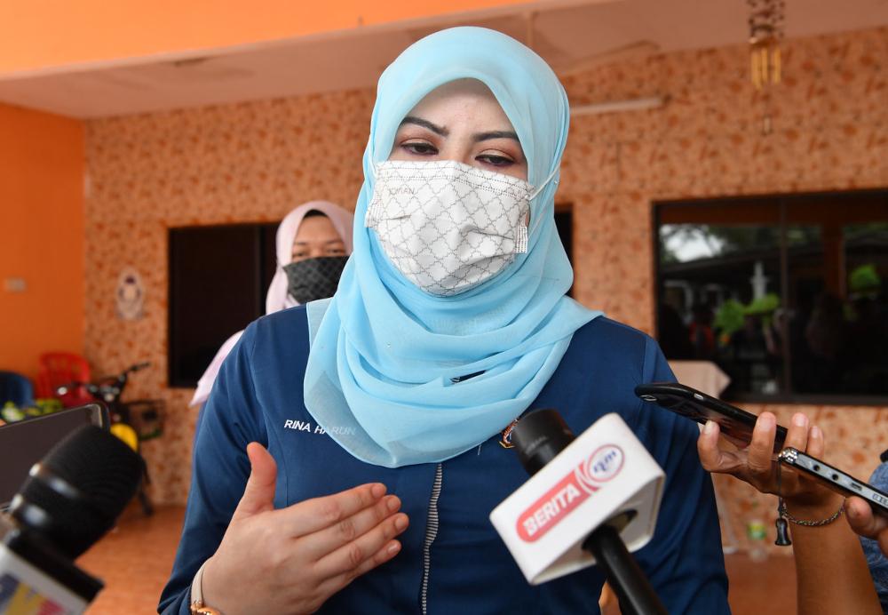 Women, Family and Community Development Minister Datuk Seri Rina Mohd Harun speaks to the media after presenting aid and food baskets in Sungai Pelek in Sepang, September 8, 2021. — Bernama pic