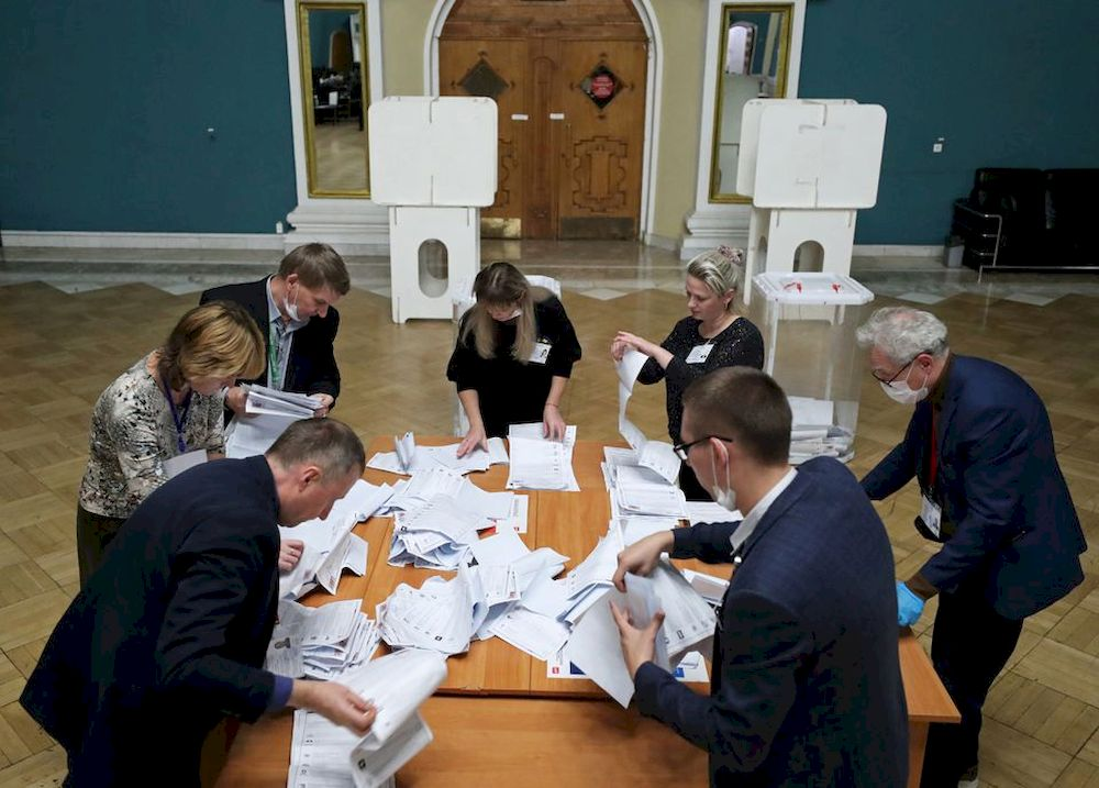 Members of a local election commission count ballots at a polling station inside Kazansky railway terminal after polls closed during a three-day long parliamentary election in Moscow, Russia September 19, 2021. — Reuters pic